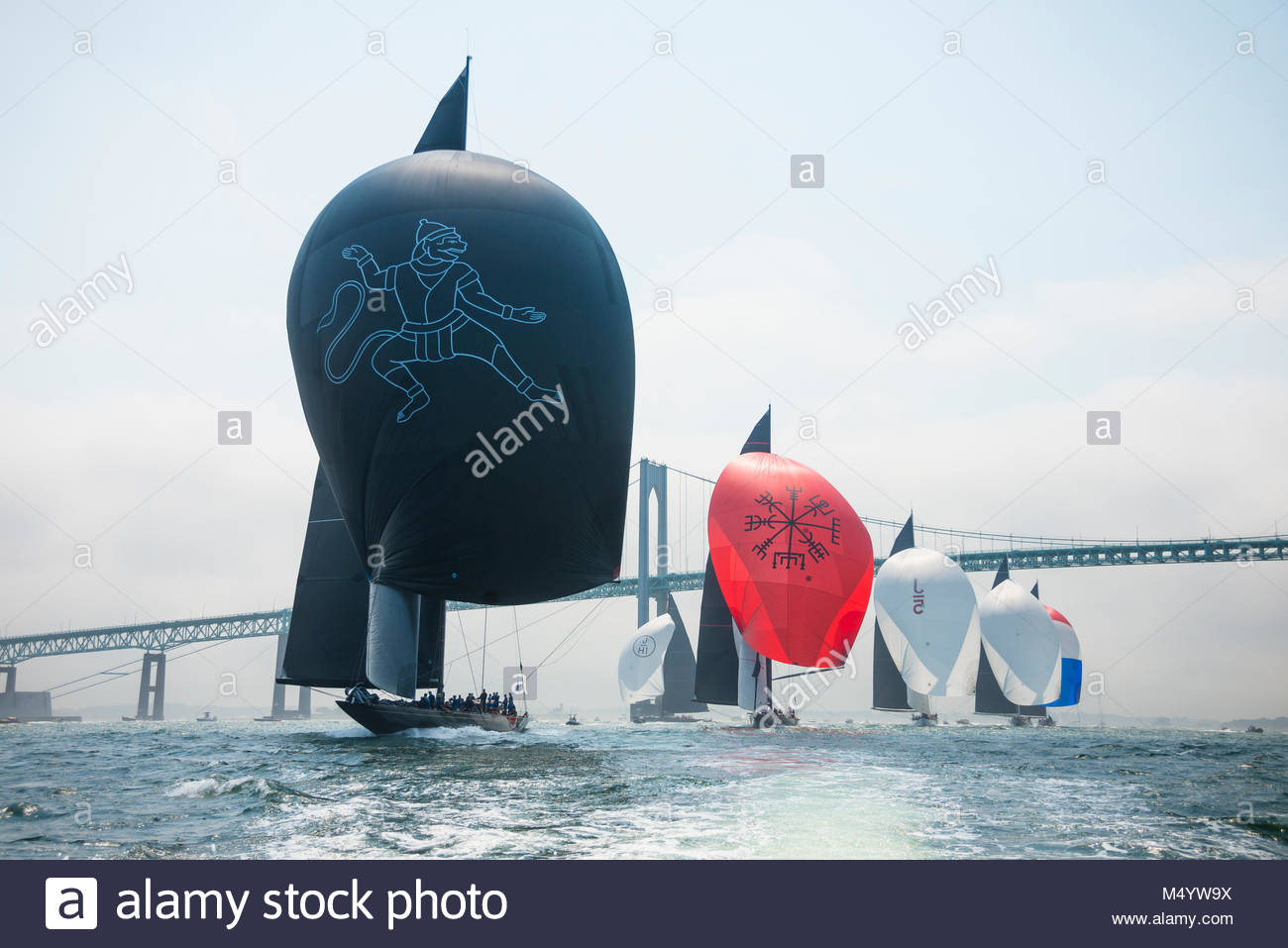 The fleet sailing downwind under the Newport Bridge in the first race of the J Class World Championship hosted in Stock Photo