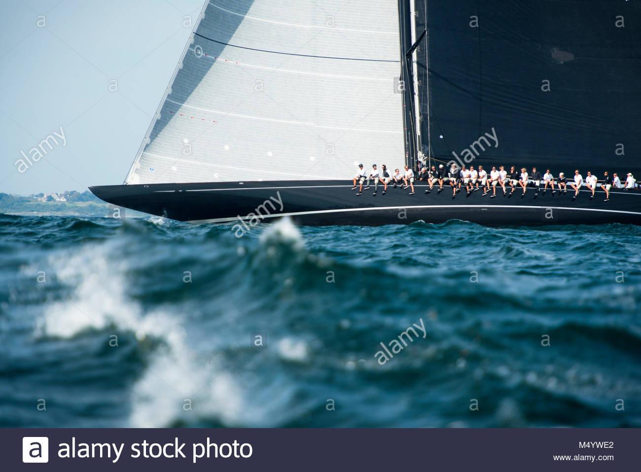 The crew of Lionheart on the rail as they sail upwind in the J Class World Championship hosted in Newport, August Stock Photo