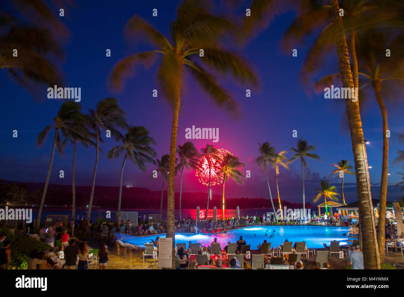 4th of July fireworks seen from tourist resort at Turtle Bay, north shore of Oahu, Hawaii Islands, USA - Stock Image
