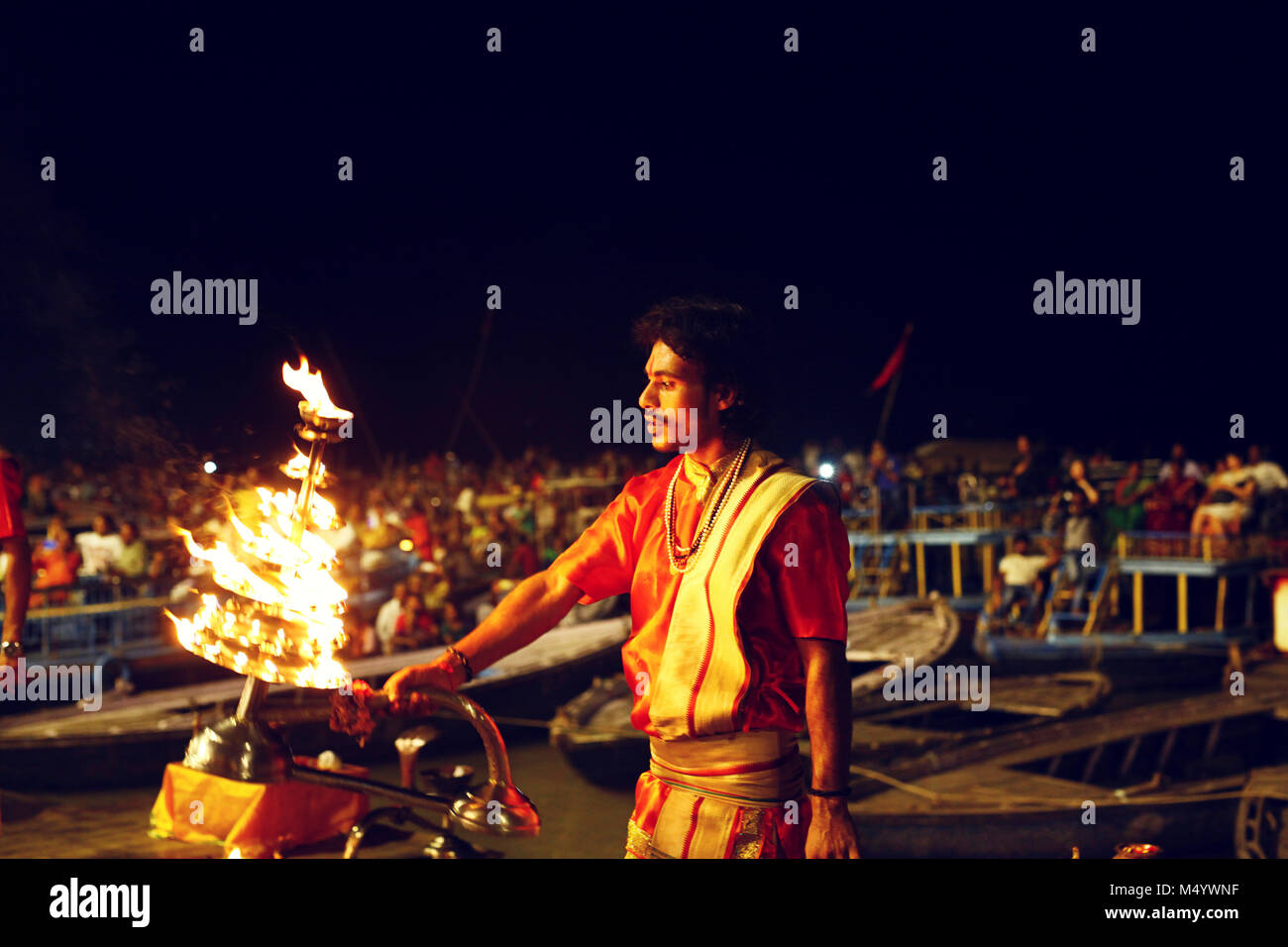 Ganga Aarti ceremony held on edge of Ganges River, Varanasi, Uttar Pradesh, India - Stock Image
