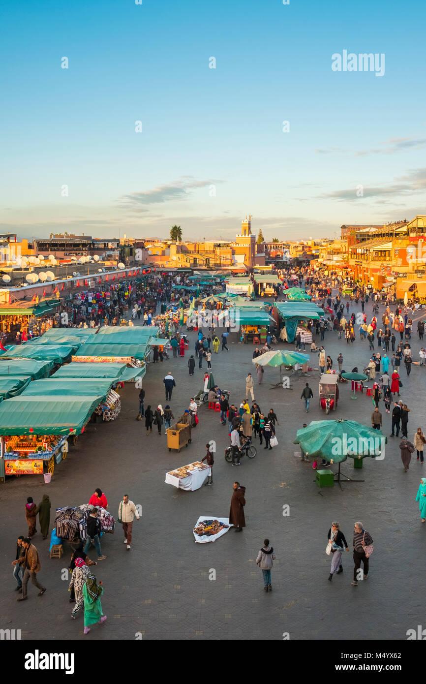 Crowded market on Jamaa El-Fna square at dusk, Marrakesh, Marrakesh-Safi, Morocco Stock Photo