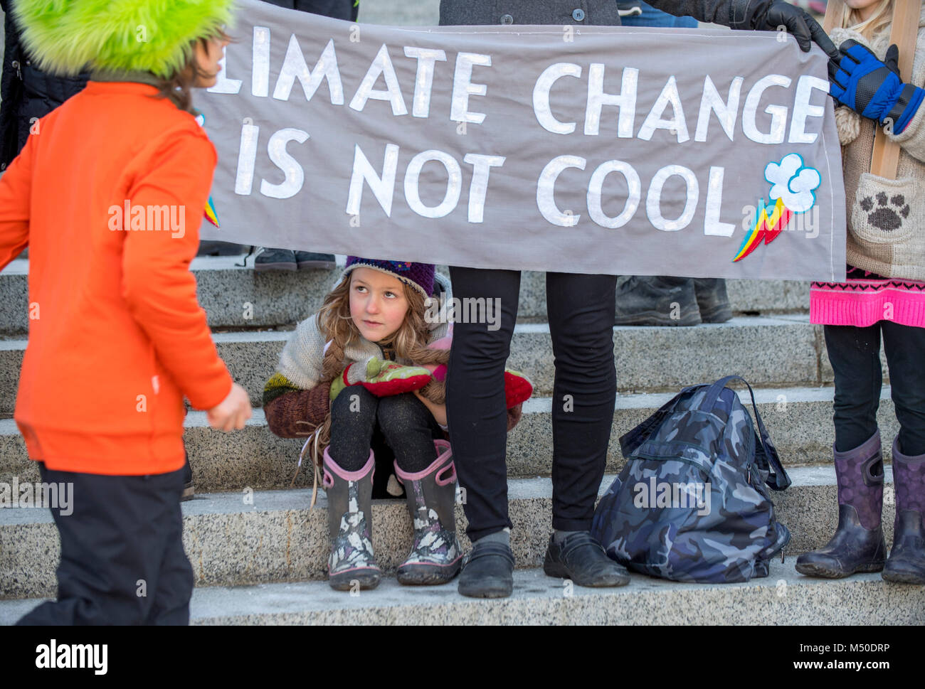 Ashlyn Molloy 5 Sits While Her Mother Holds A Sign During A Rally On The Steps Of The Capitol Building In Olympia On Monday