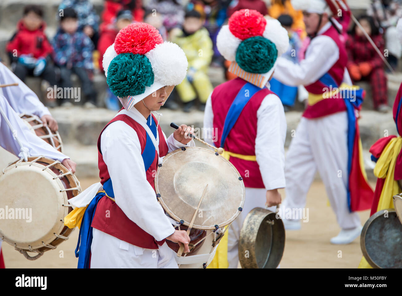 The farmers dance occurred to celebrate the harvest in Korea. - Stock Image