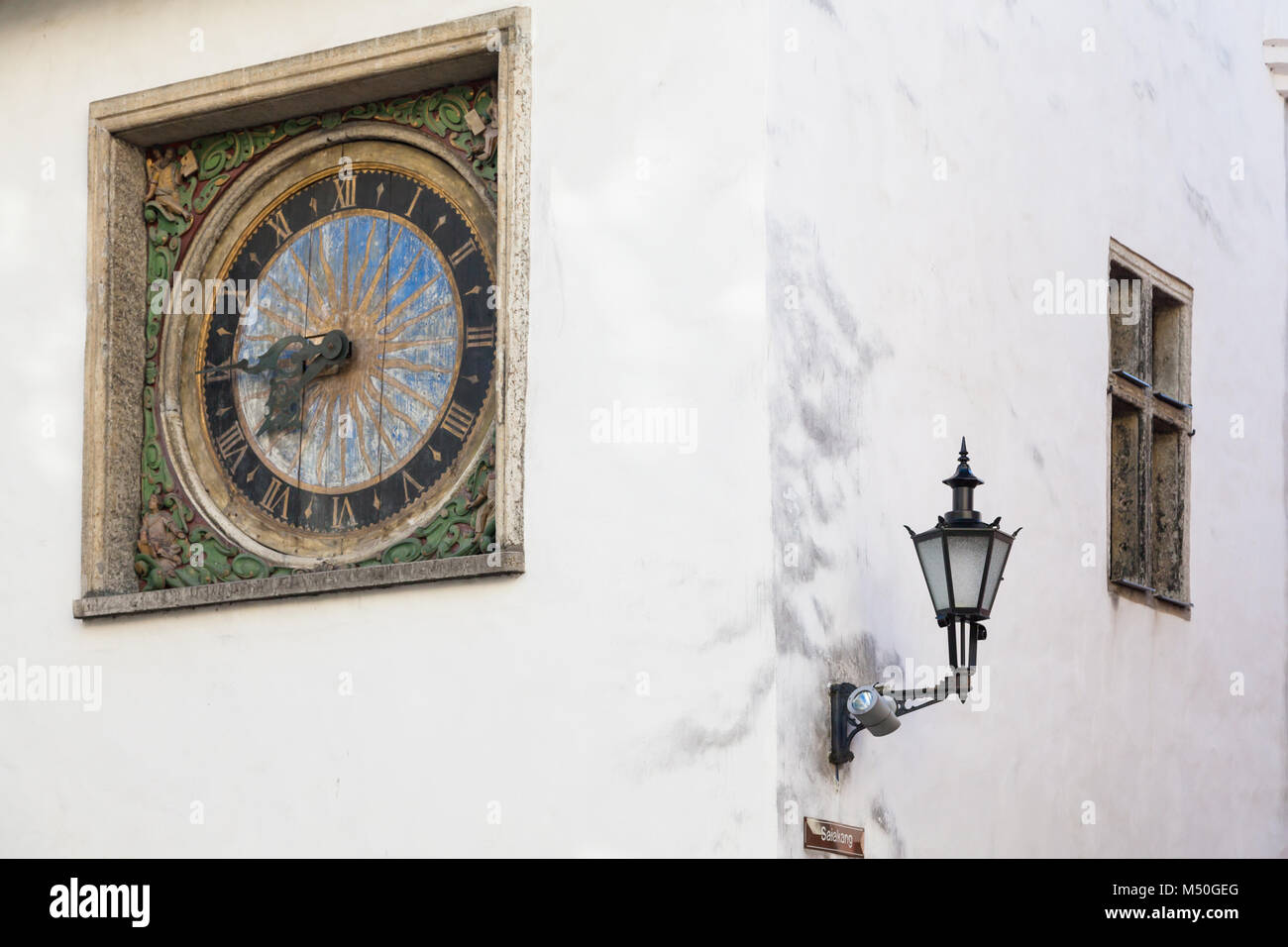 Ancient clock on the wall of the Church of the Holy Spirit in Old Tallinn, master Christian Ackerman 1684 - Stock Image