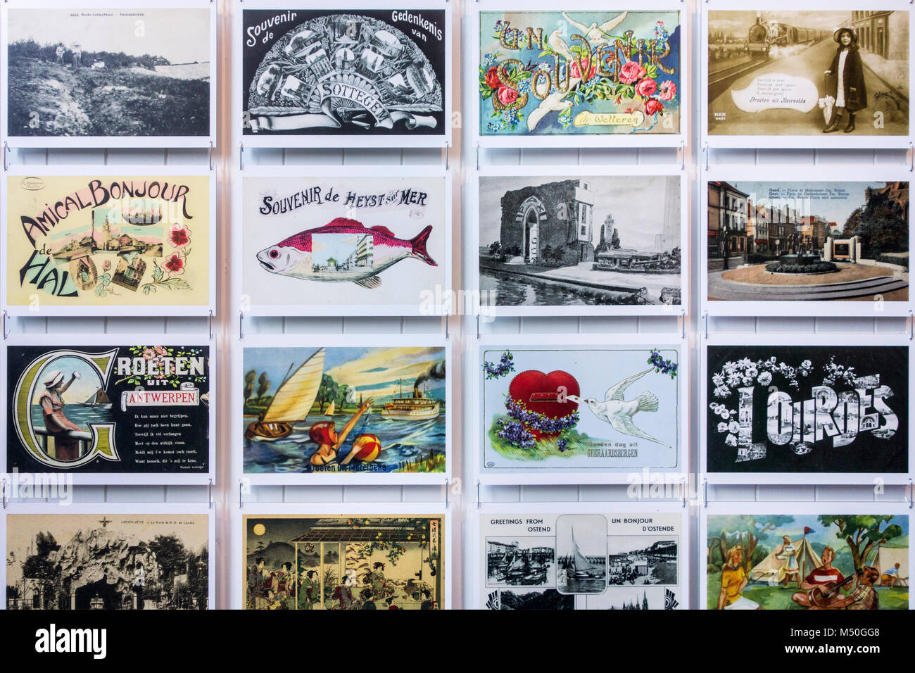 Collection of vintage postcards of the early 20th century showing drawings and old photographs of holiday destinations - Stock Image
