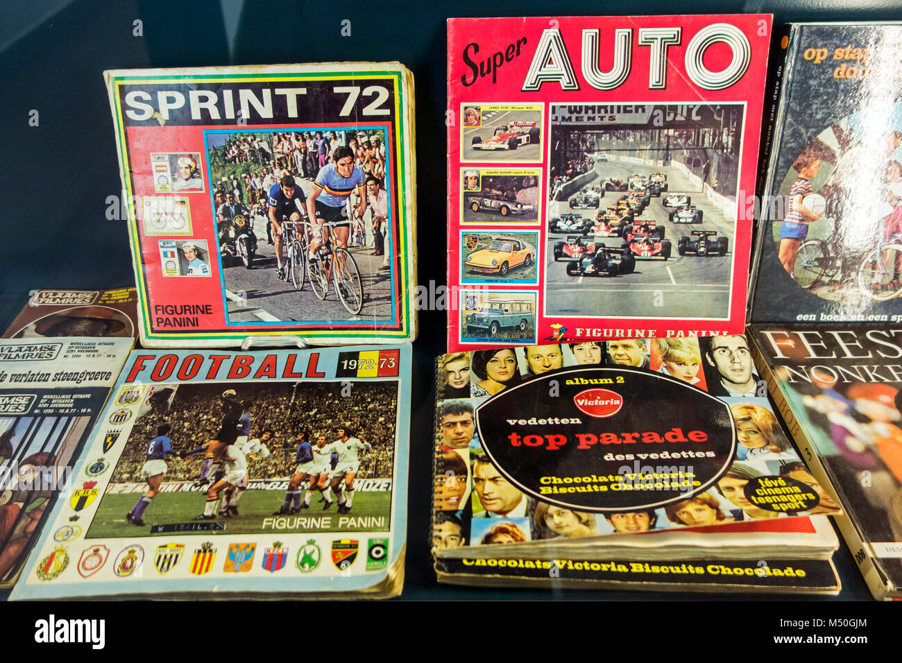 Vintage Panini sticker albums from the seventies about football / soccer, cycling and cars - Stock Image