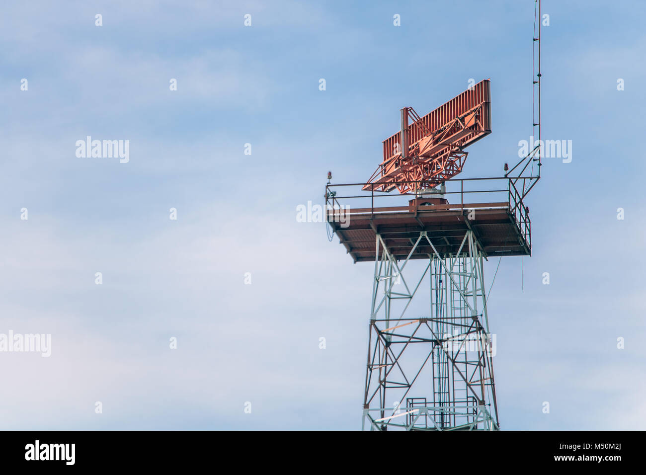 The radar rotates on the tower. The radar works on the steel construction. - Stock Image