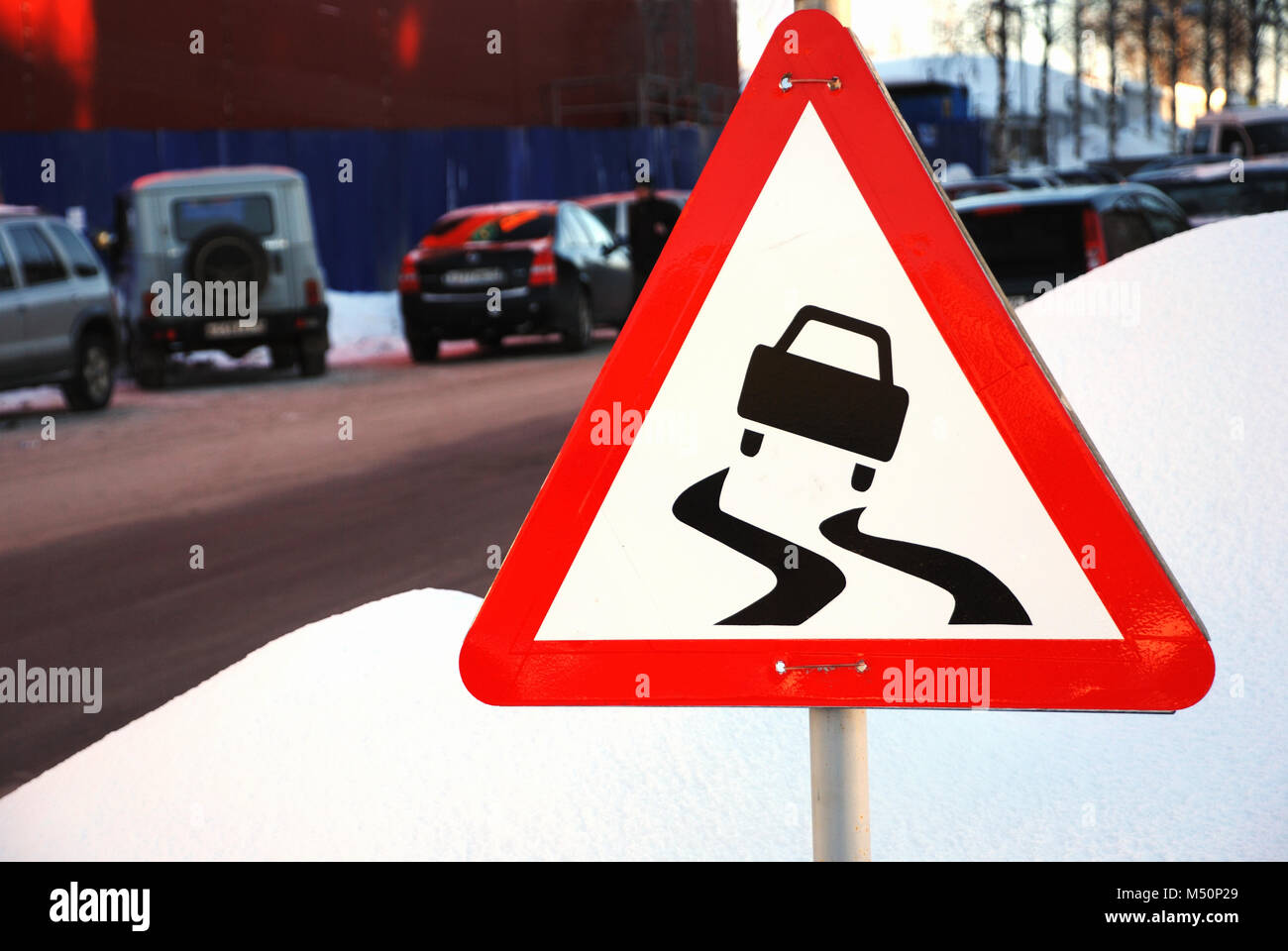 varning sign for slippery road ahead - Stock Image