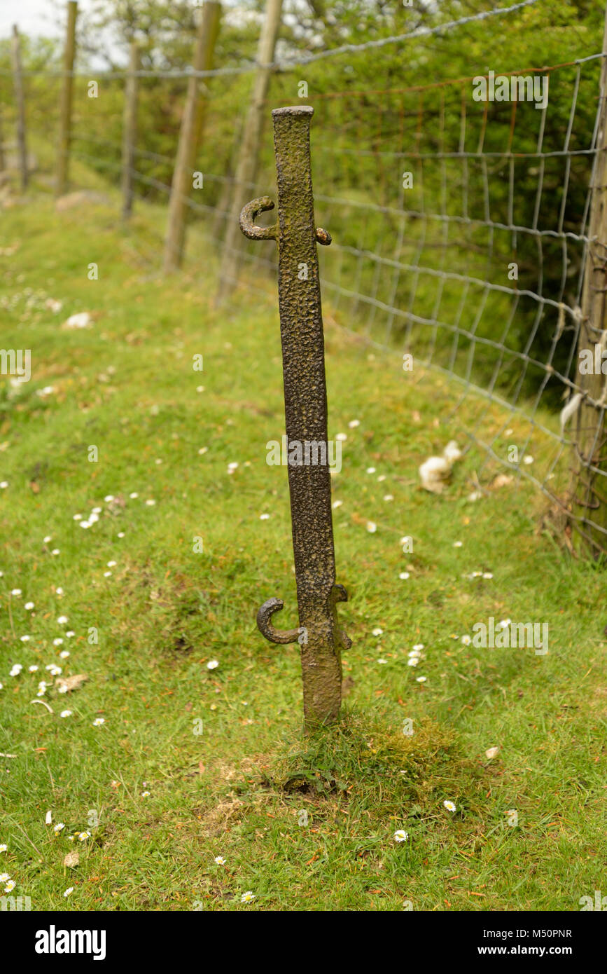 Old fence post on the path of Hill's Tramroad, Blaenavon Heritage Area - Stock Image
