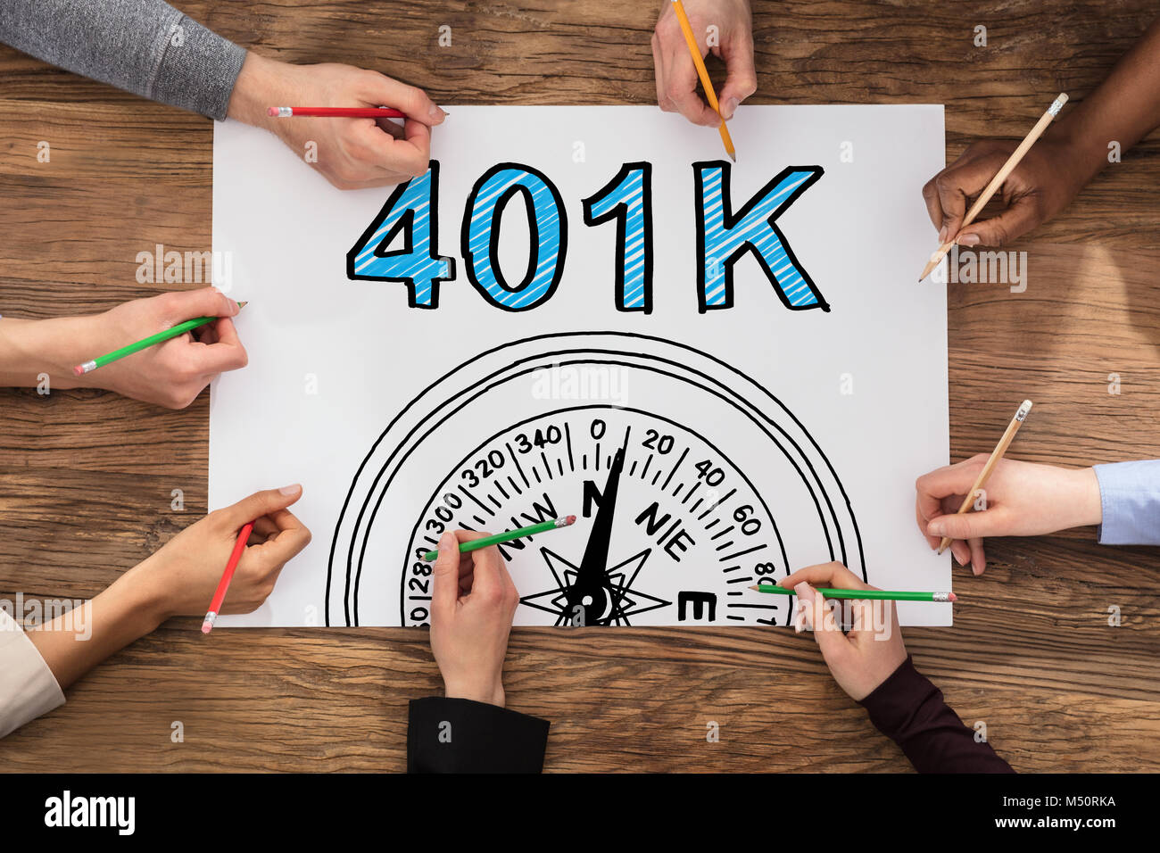 High Angle View Of Group Of People Drawing 401k Pension Plan - Stock Image