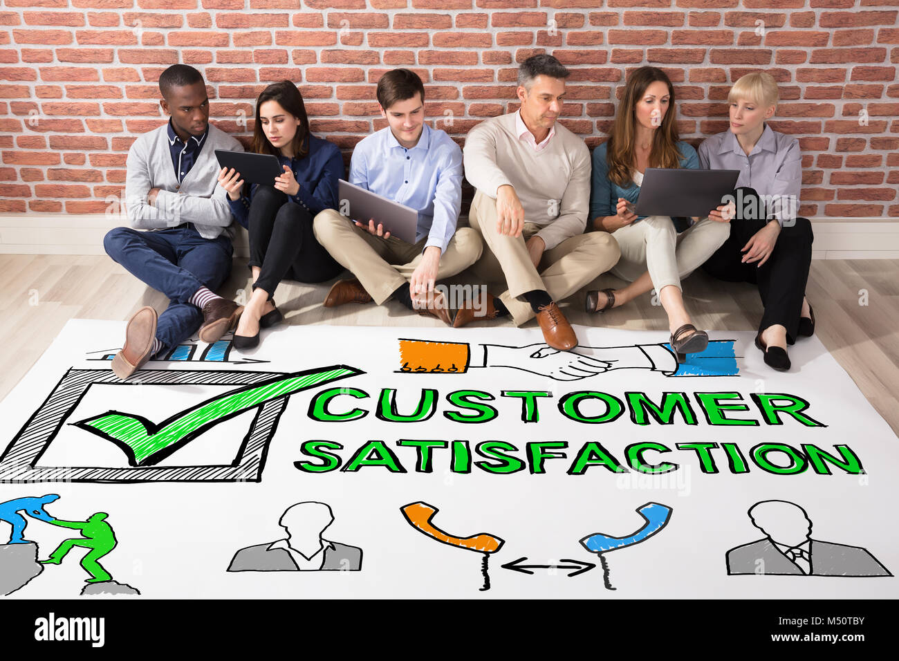 Group Of People Looking At Customer Satisfaction Survey Concept - Stock Image
