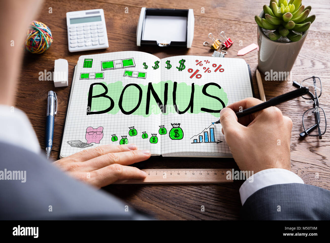 Man Drawing Bonus And Employee Compensation Concept - Stock Image