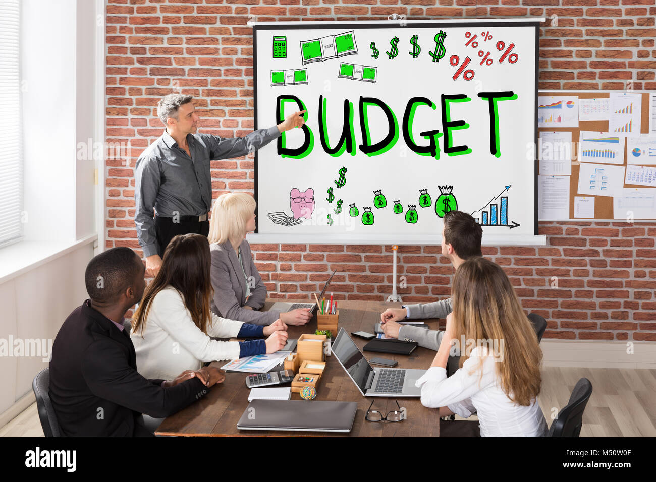 Group Of People At Budget And Finance Presentation - Stock Image