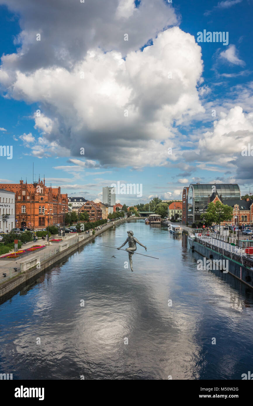 The tightrope walker sculpture in Bydgoszcz Stock Photo