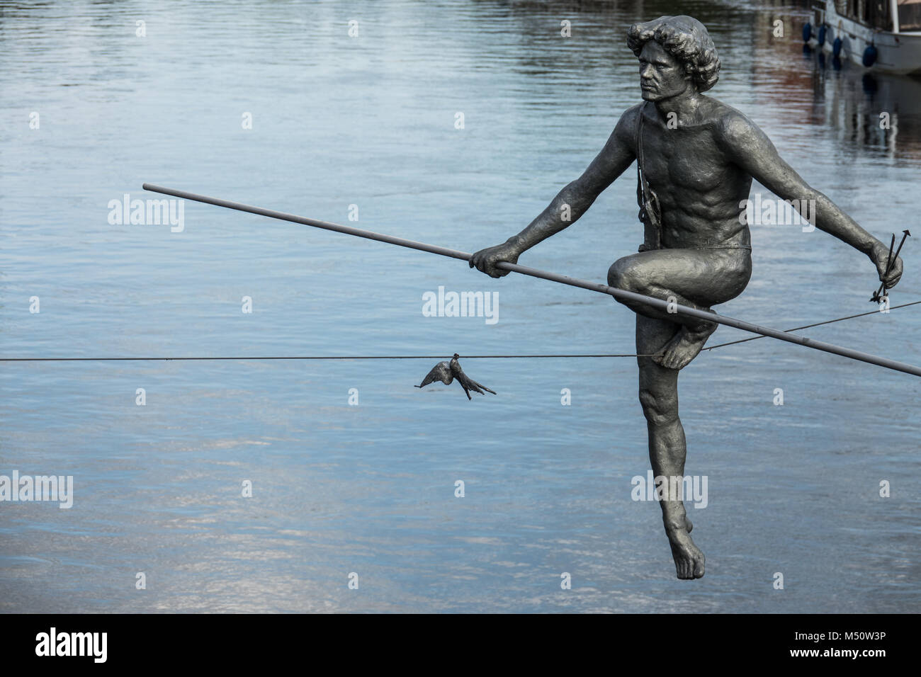 The tightrope walker sculpture closeup - Stock Image