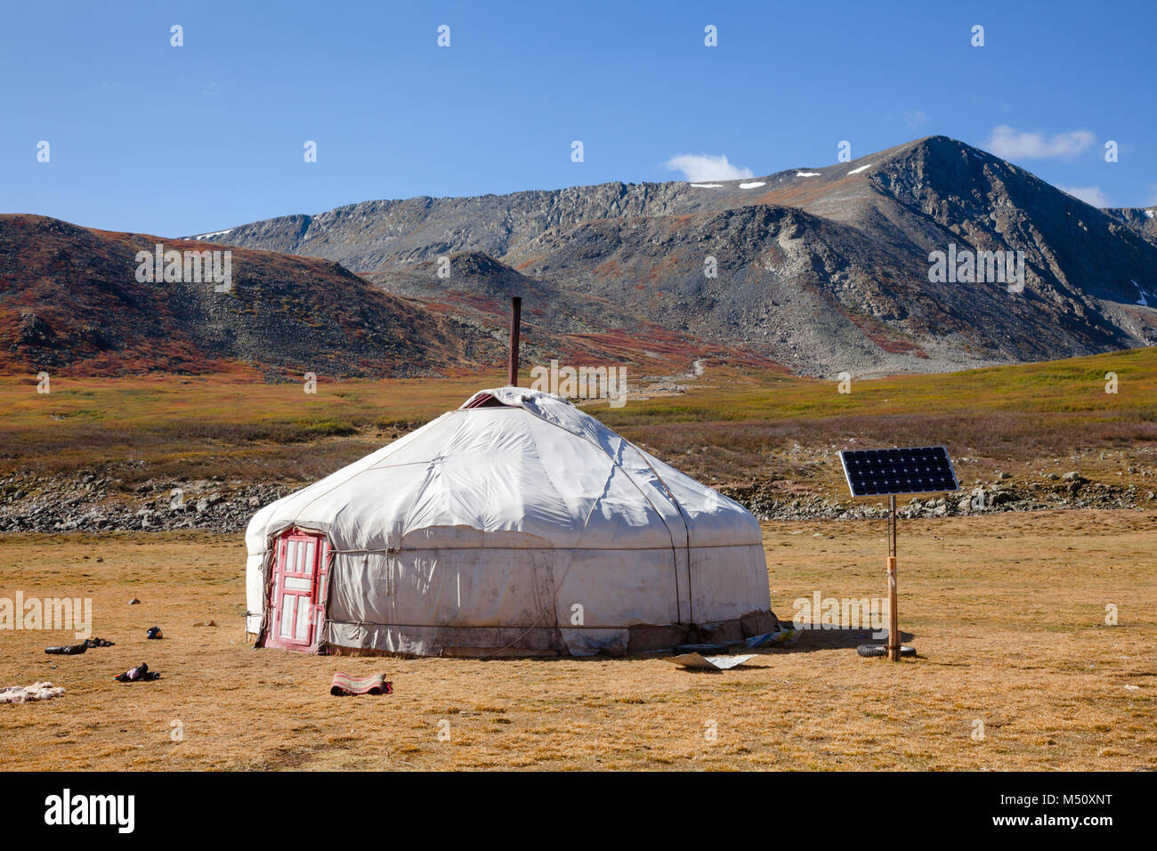 Traditional Mongolian portable round tent ger covered with white outer cover powered by solar panel in Altai Mountains - Stock Image