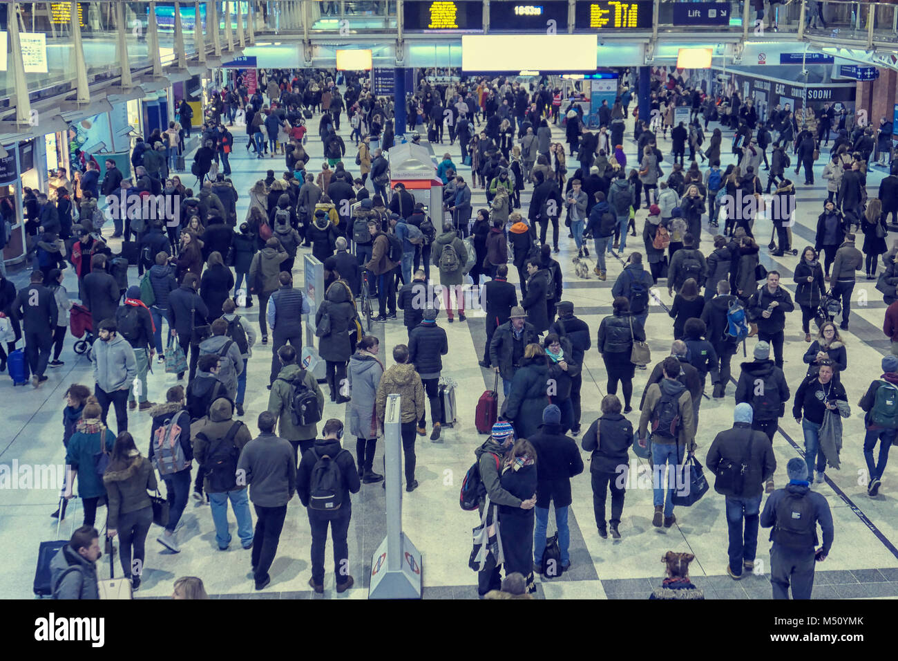 LONDON, UK-FEBRUARY 9, 2018: Inside Liverpool Station in London, people rushing around as seen from above view - Stock Image