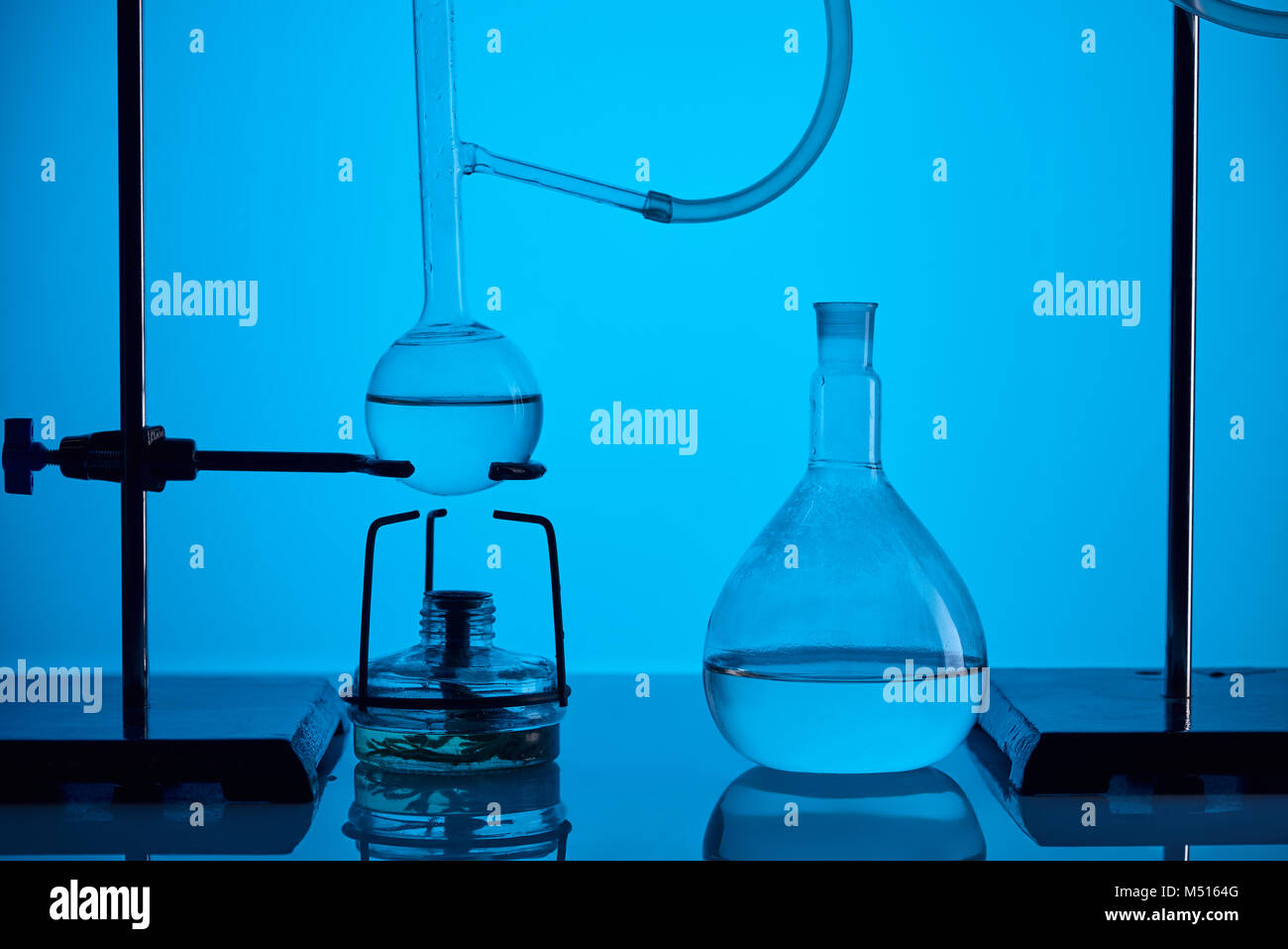 chemical test with substance in laboratory on blue - Stock Image
