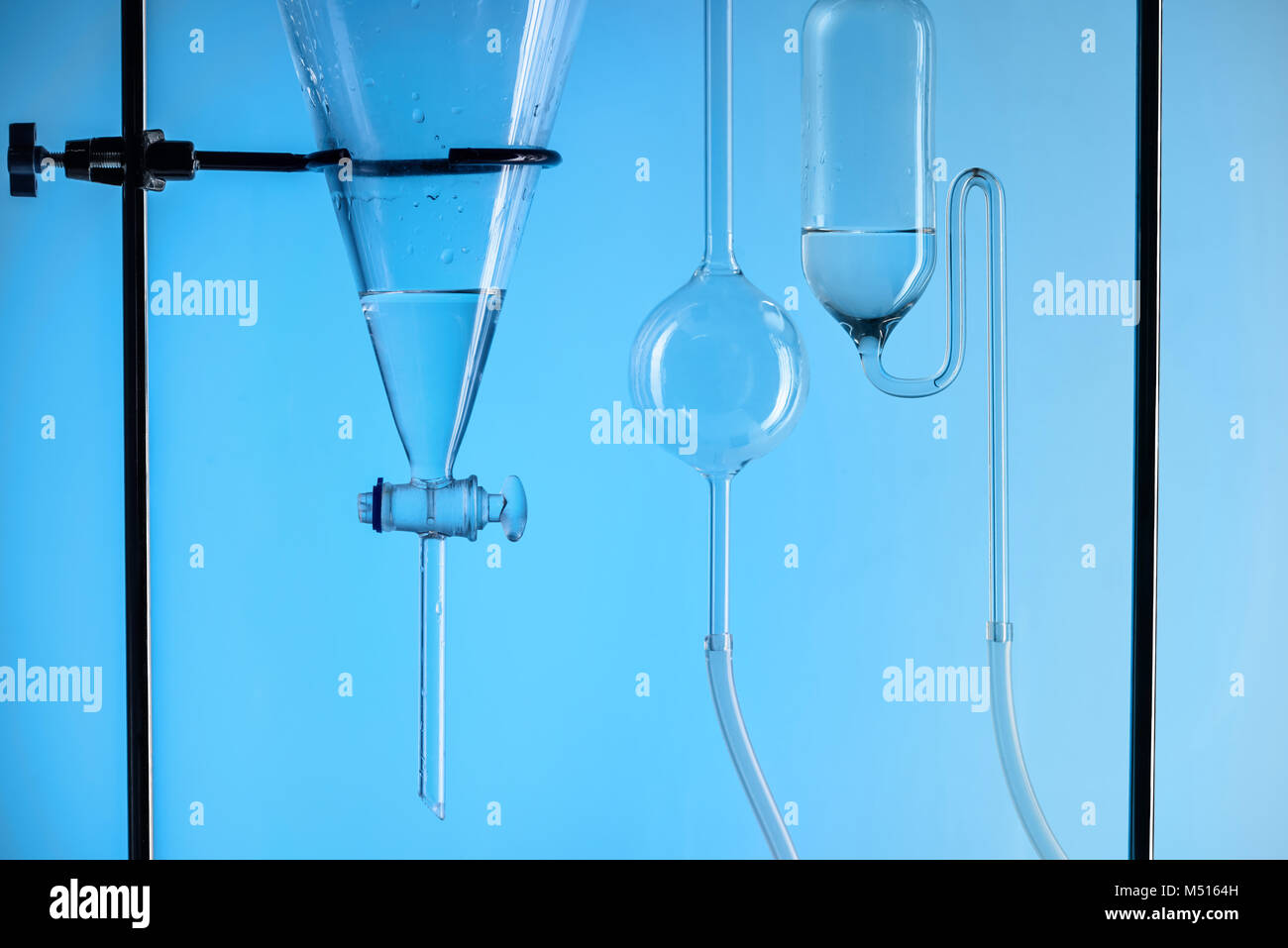 chemical test with substance in laboratory isolated on blue - Stock Image