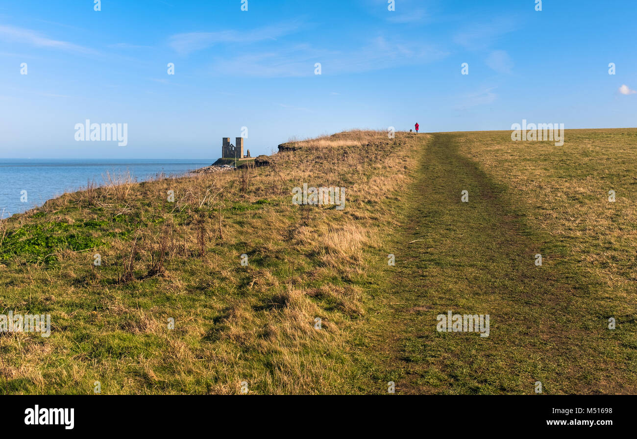 Pathway along the grass covered coastal clifftops of Reuclver country park near to Reculver Towers, in Kent, UK Stock Photo