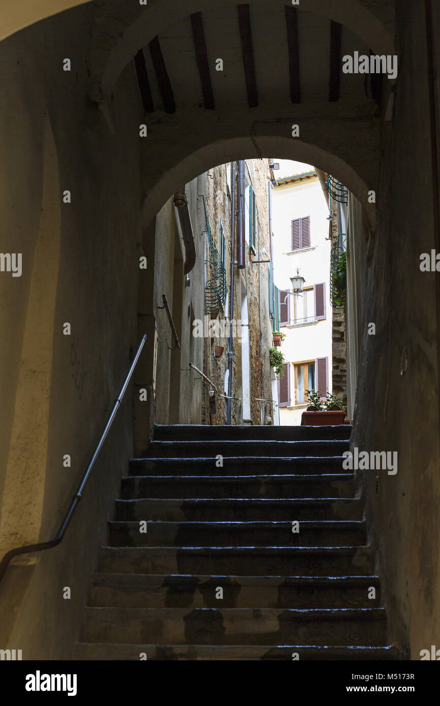 Staircase in a dark vaulted alley Stock Photo