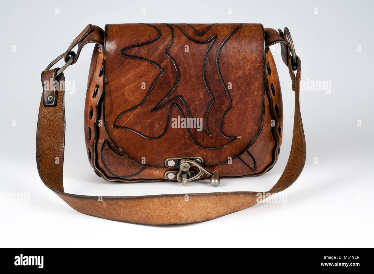 A Hard Brown Leather Purse Or Bag With Mechanical Catch - Stock Image