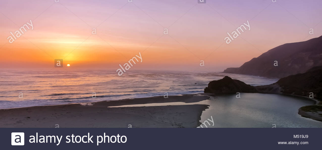 Sunset over Little Sur River mouth. - Stock Image