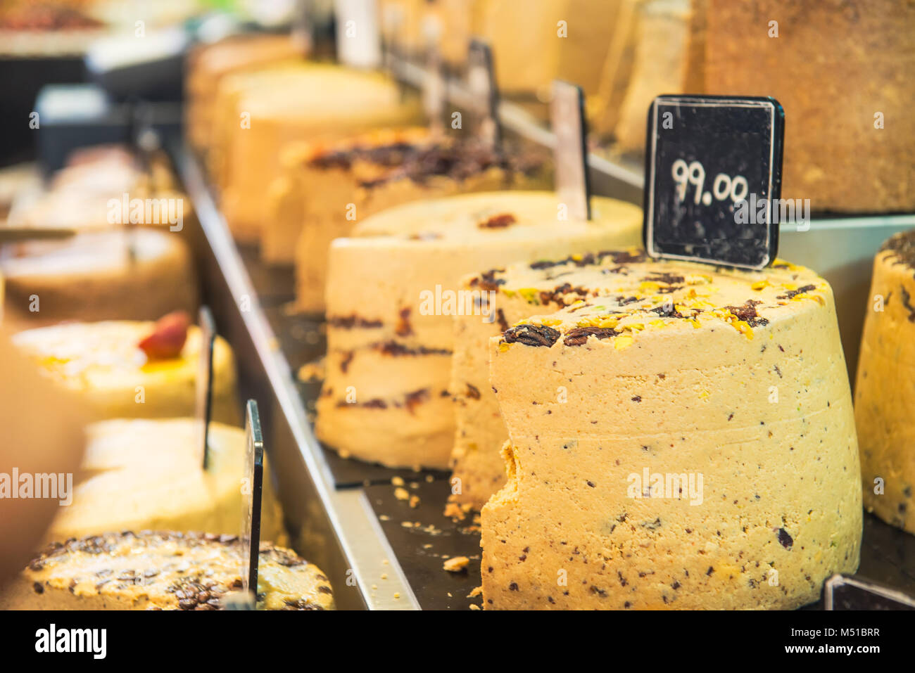Close up of big pieces of eastern sweet halva on market place of Tel Aviv, Israel . Selective focus - Stock Image