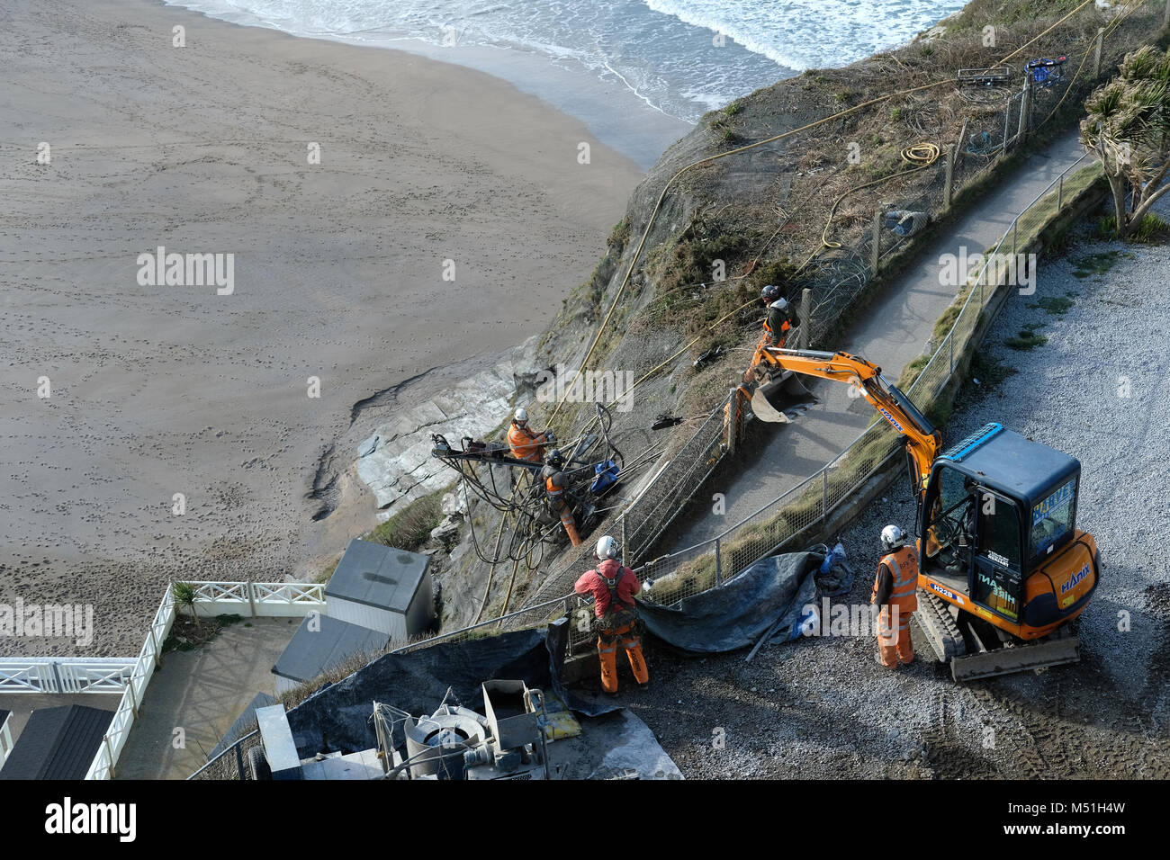 Men working on cliff repairs in Newquay, Cornwall. - Stock Image
