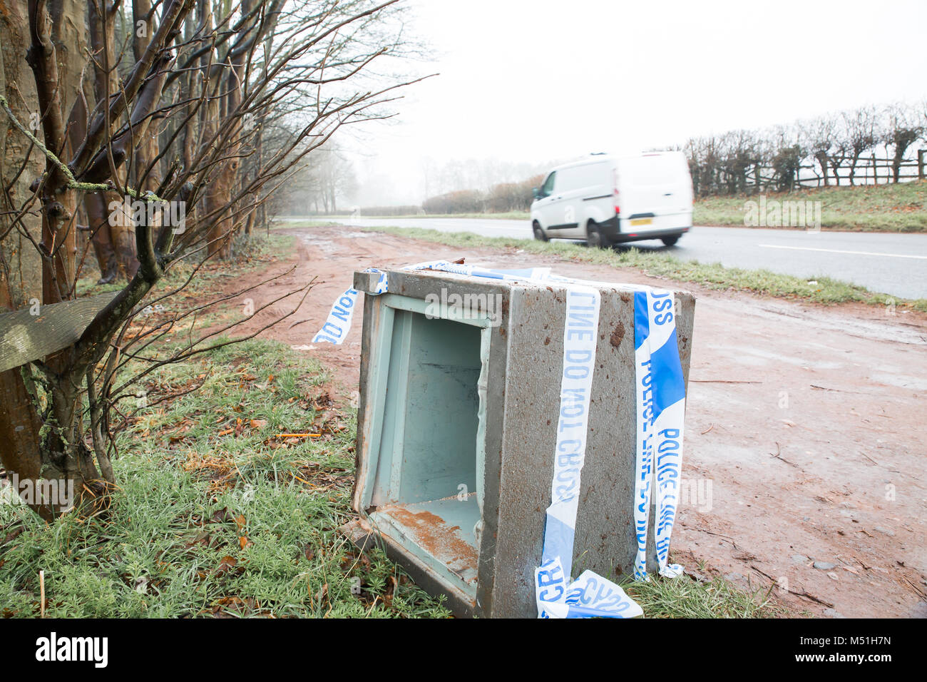 Vandalized safe damaged by brute force in professional robbery, dumped by thieves in country road lay-by. Police - Stock Image