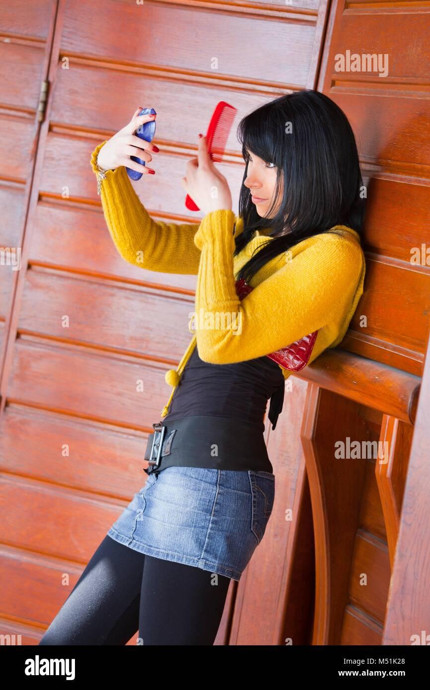 Pretty teen girl wearing short denim mini-skirt miniskirt - Stock Image