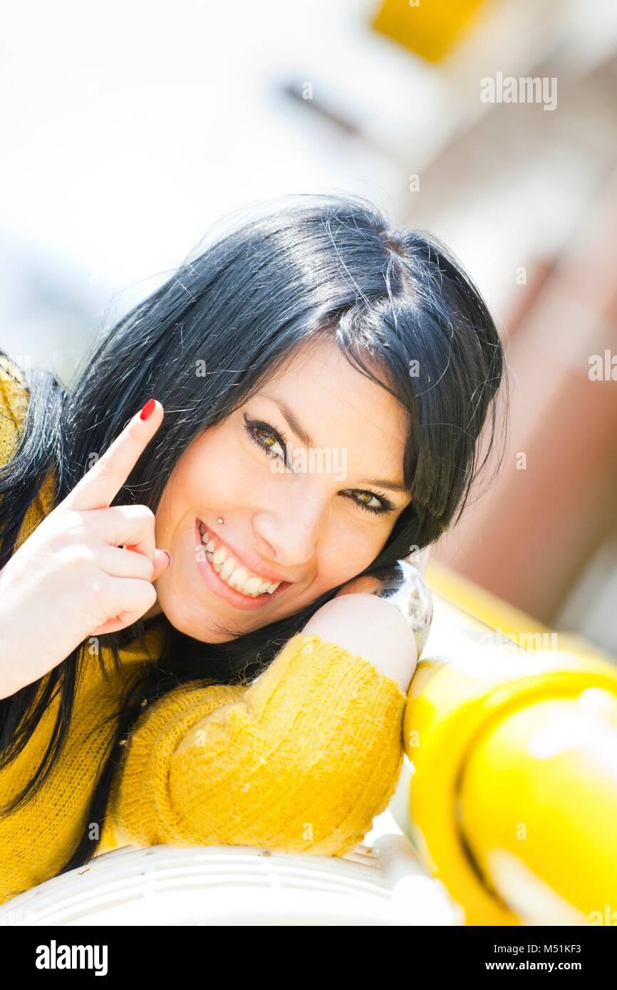 Pretty teen girl girls happy finger - Stock Image