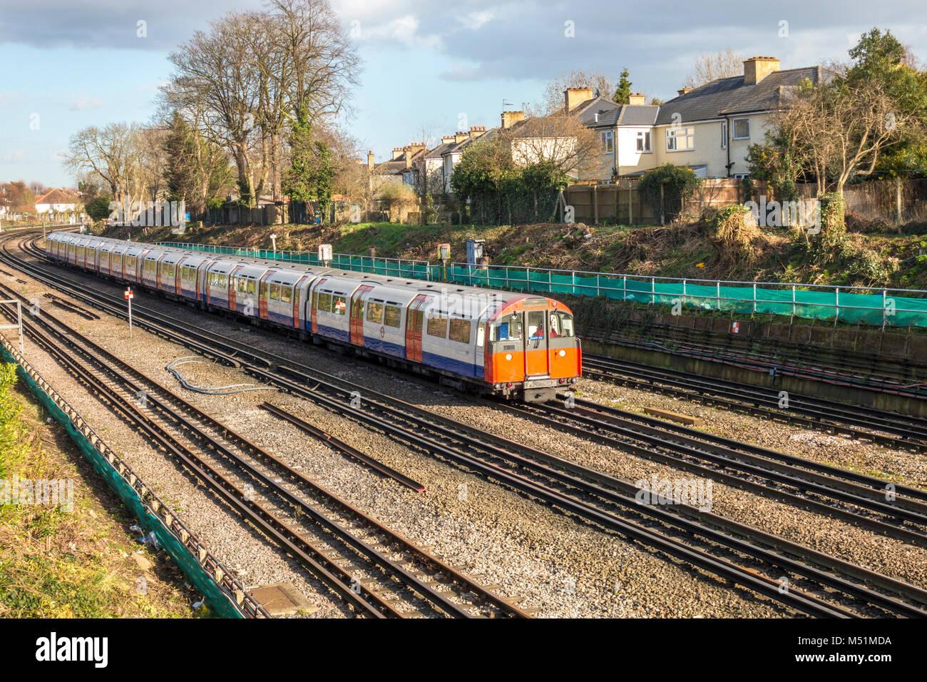 London Underground (LUL) tube train, travelling overground, approaching South Ealing station, London W5, England, - Stock Image