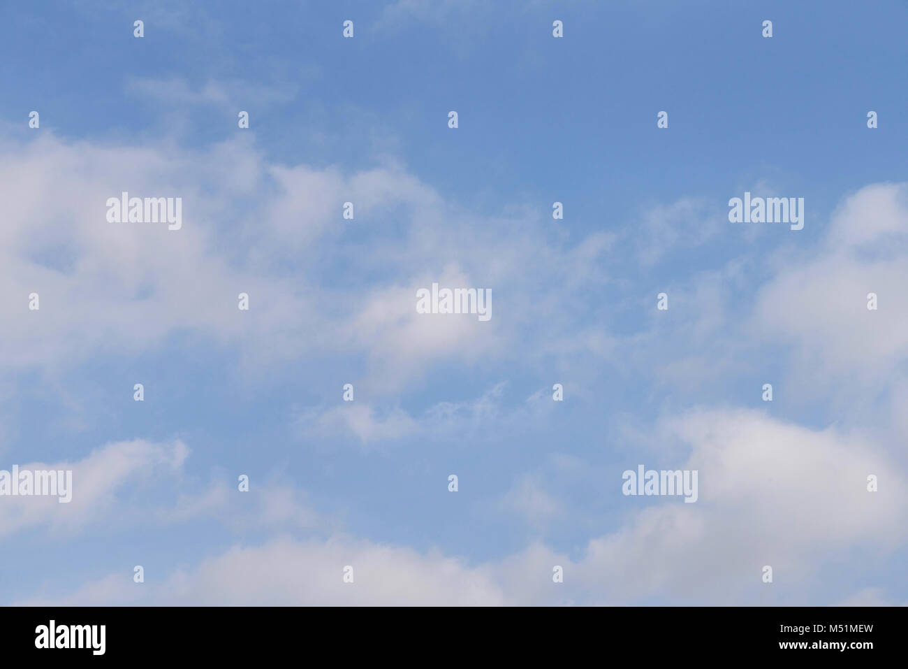 Blue sky with white fluffy clouds. - Stock Image