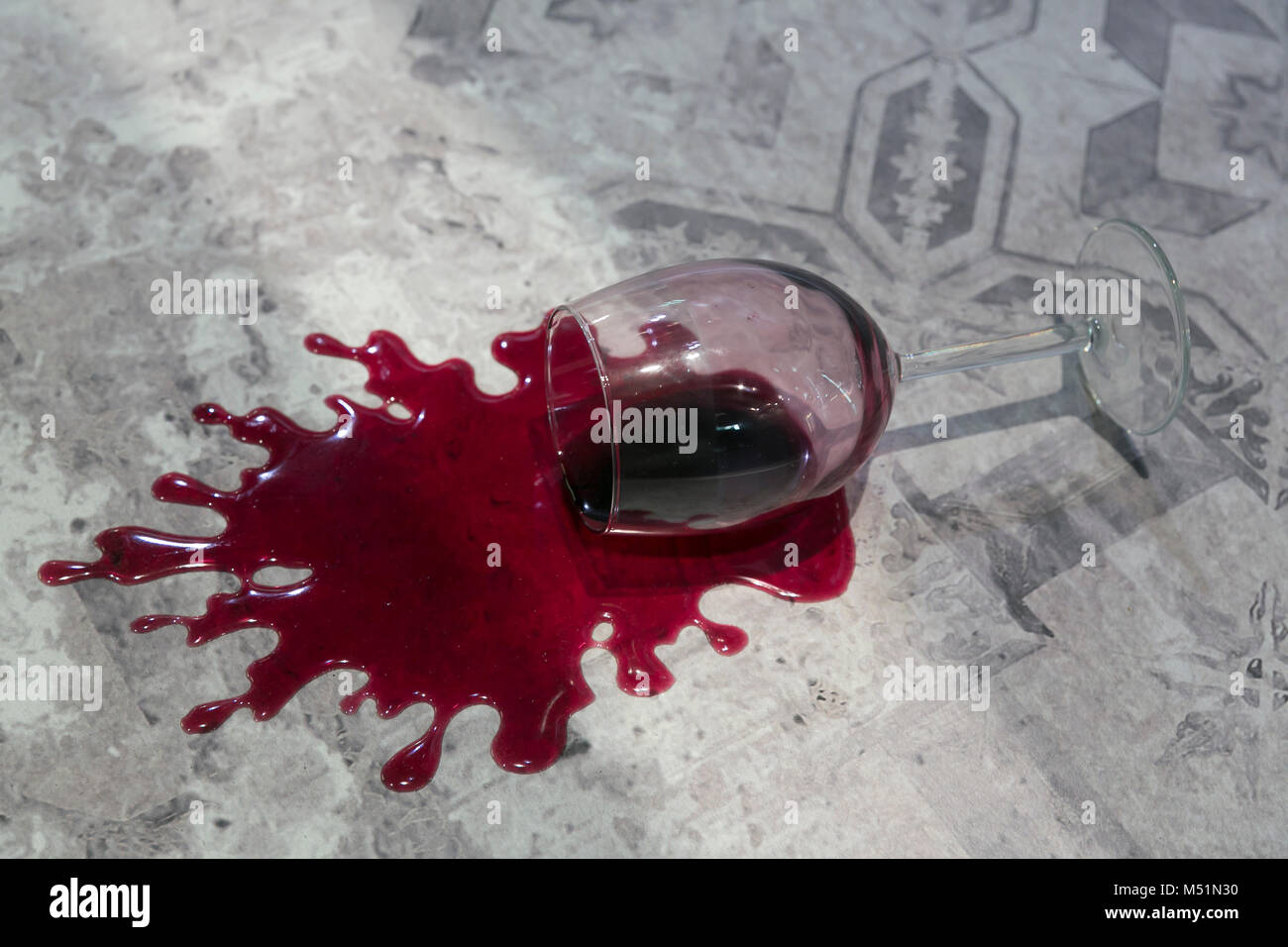 tumbled glass with red wine - Stock Image