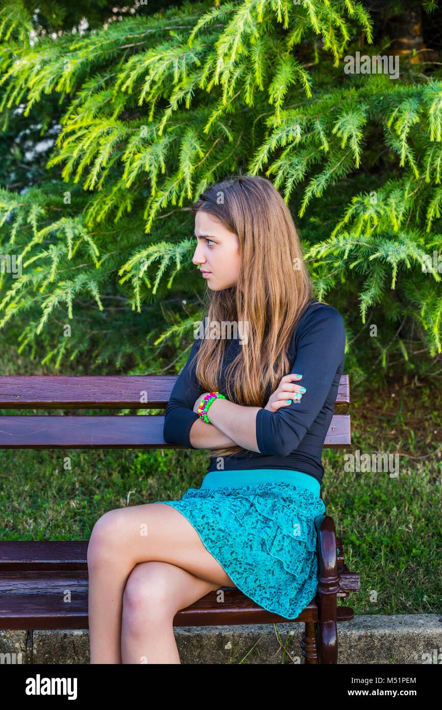 Upset sorry about past stubborn teen girl womans womens model-released release alpfabet - Stock Image