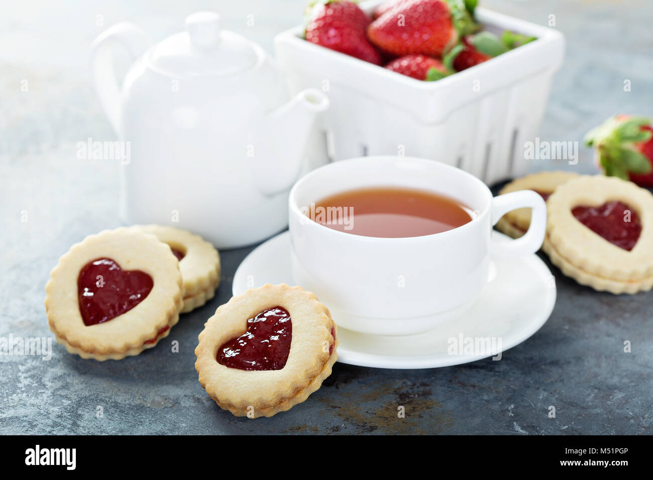 Vanilla linzer cookies with strawberry jelly filling and heart cutouts - Stock Image