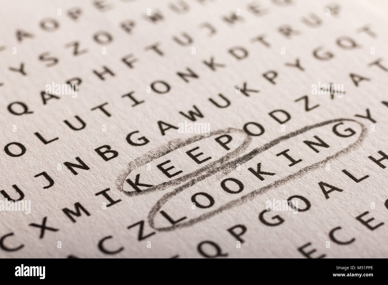 Word search, puzzle. Close up of letters on canvas. Concept about finding, keep looking, persistence. - Stock Image