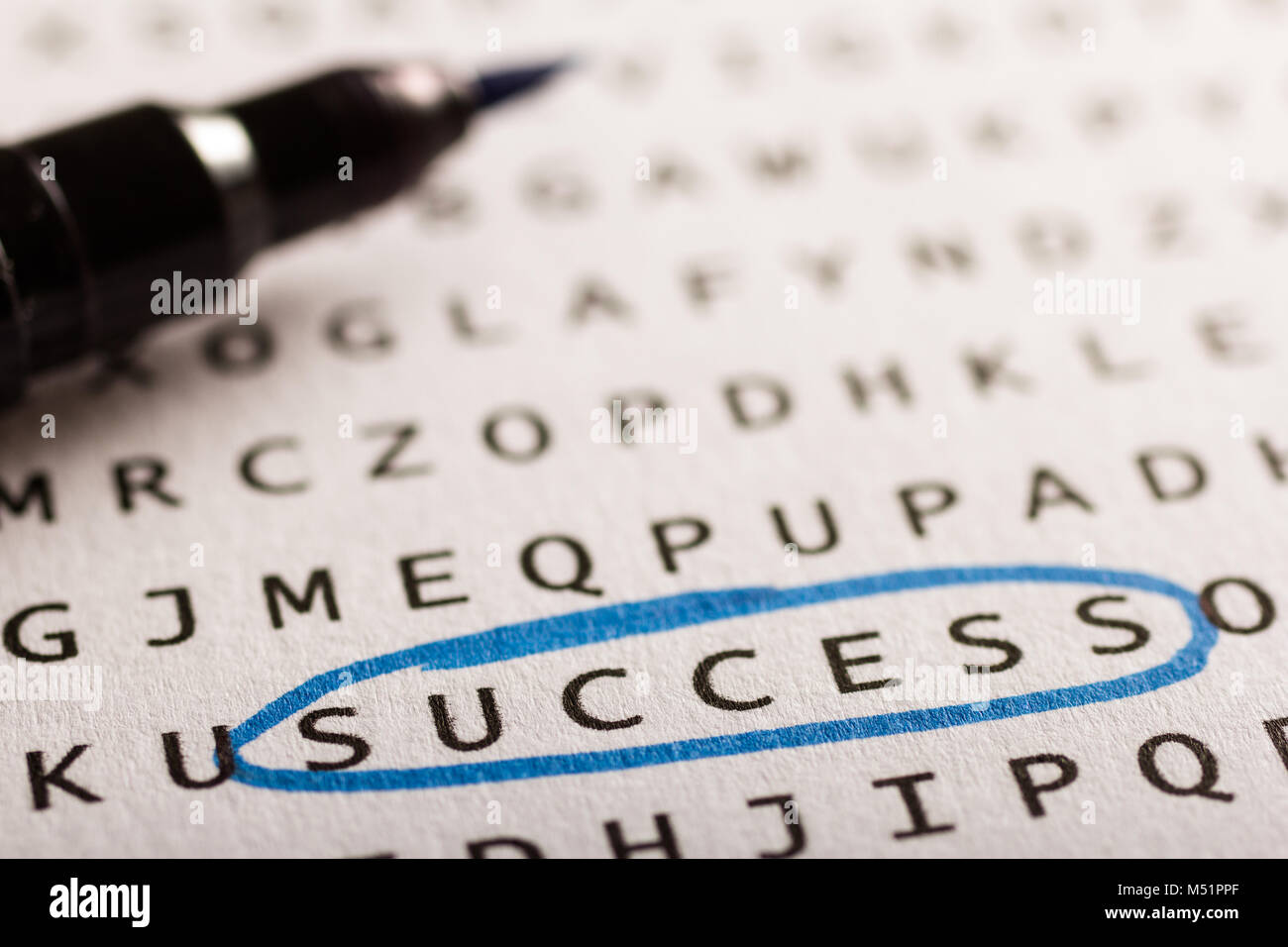 Word search, puzzle. Close up of letters on canvas. Concept about finding, success, business. - Stock Image