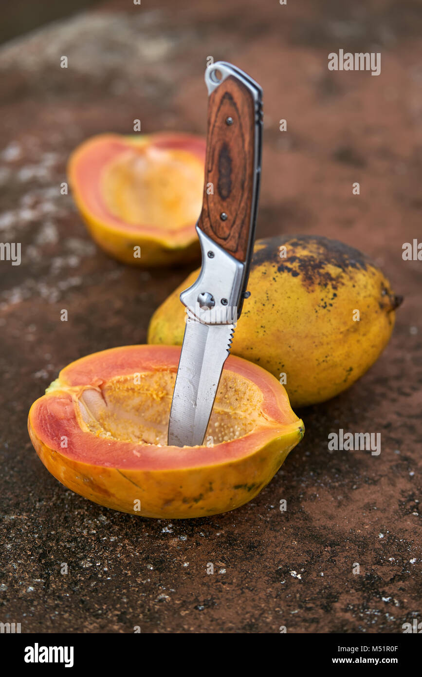Tasty papayas and knife - Stock Image