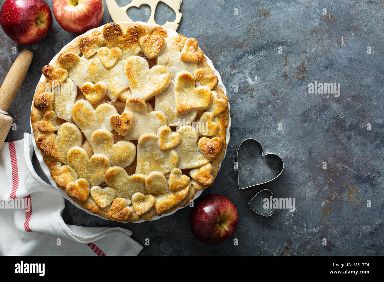 Apple pie with hearts shaped crust homemade treat for Valentines Day - Stock Image