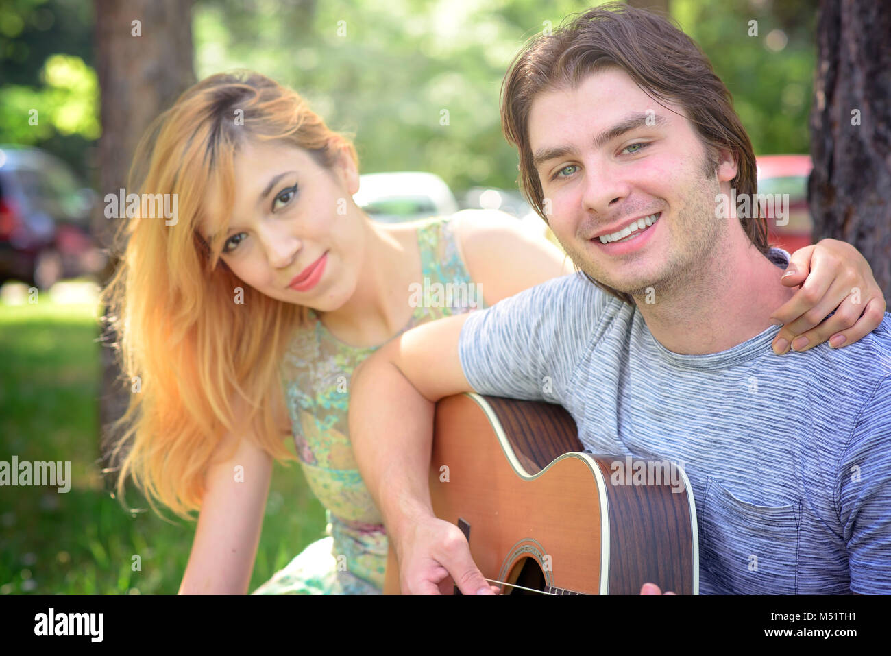 Sweet couple in love in the park - Stock Image