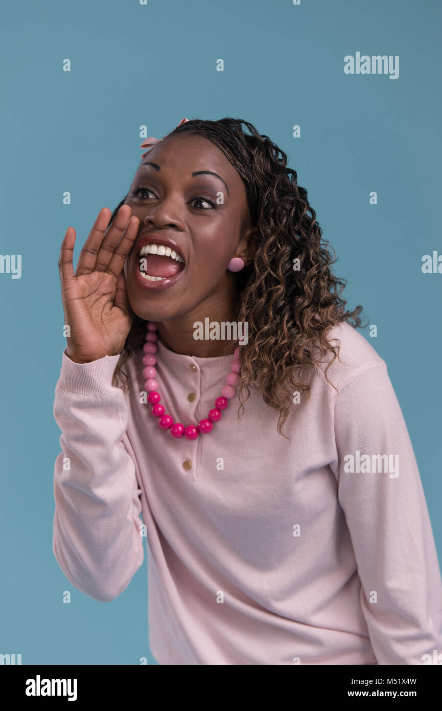 Young African Woman Shout And Scream Using Her Hands As Tube Studio Shoot Isolated On Blue