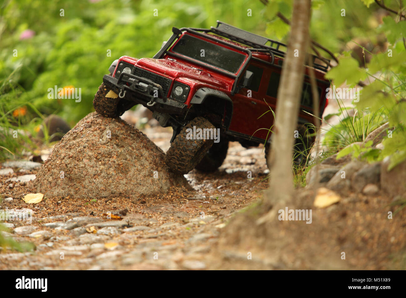 Off-road vehicle go around obstacles - Stock Image