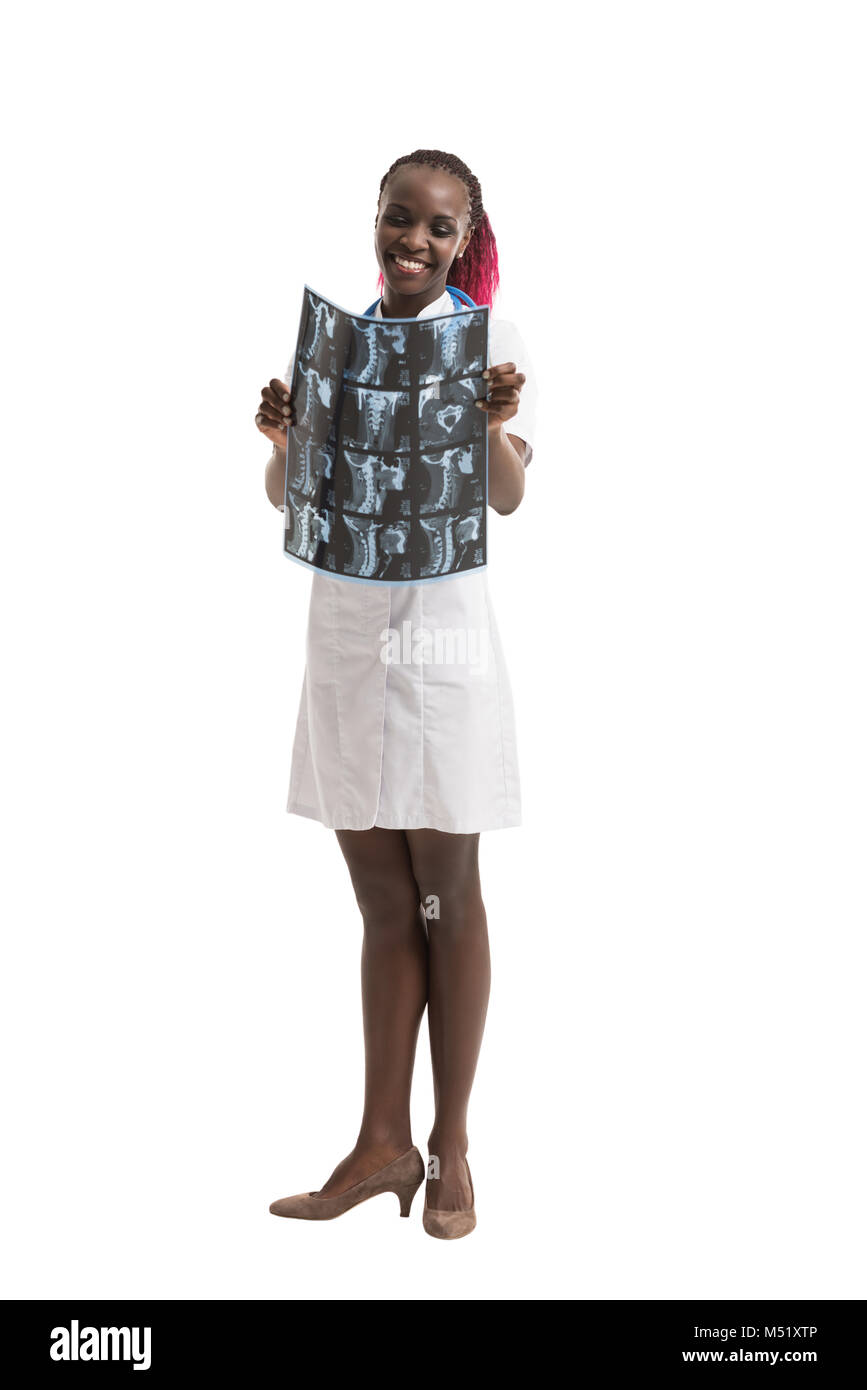 Closeup portrait of intellectual african woman healthcare doctor with white labcoat, looking at neck x-ray radiographic - Stock Image
