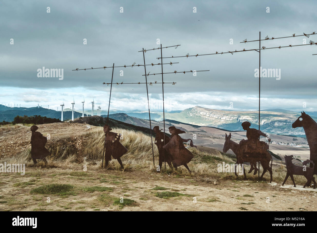 Caravan of pilgrims sculpture by Vicente Galvete on road to Santiago de Compostela, Pamplona, Navarre, Spain - Stock Image