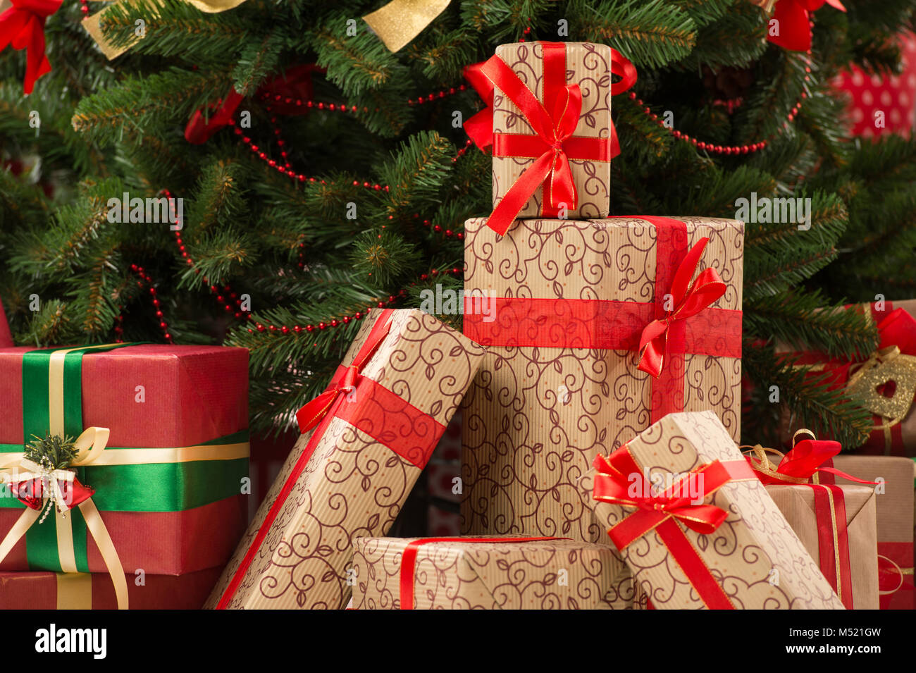 Stack Of Gift Boxes Under Christmas Tree Stock Photo Alamy