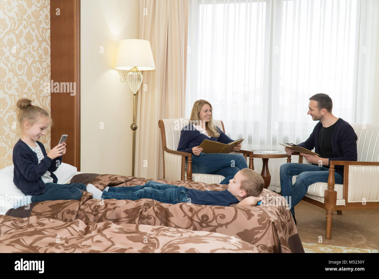 The Husband And Wife And The Children In The Hotel Room A