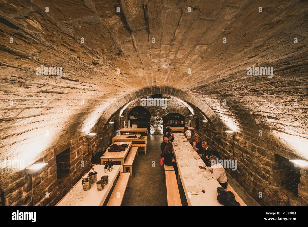 Dinner inside old wine cellar, Pamplona, Navarre, Spain Stock Photo