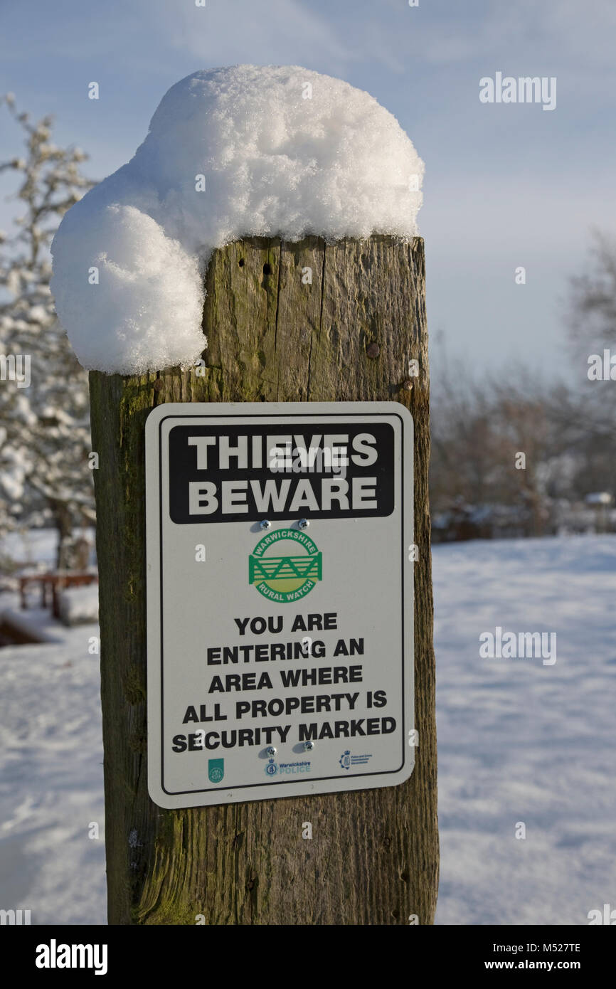 Thieves beware notice on post Cotswolds UK - Stock Image
